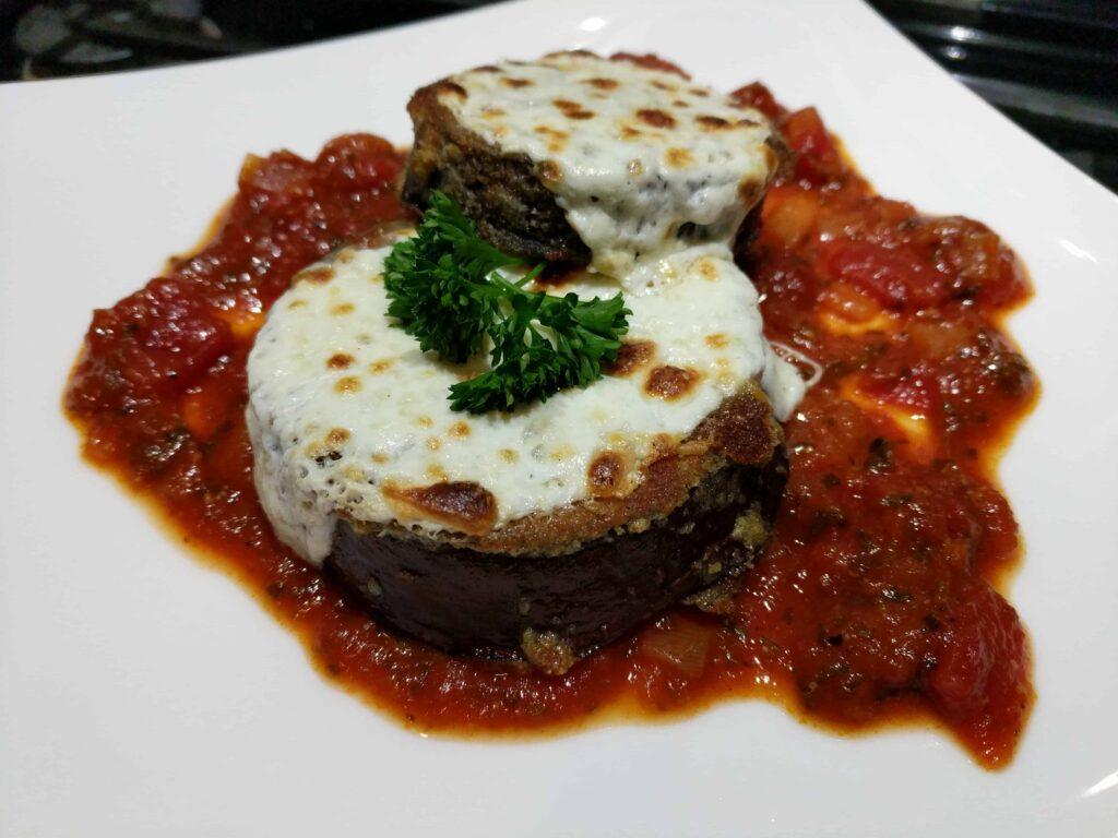 eggplant mozzarella on a white plate