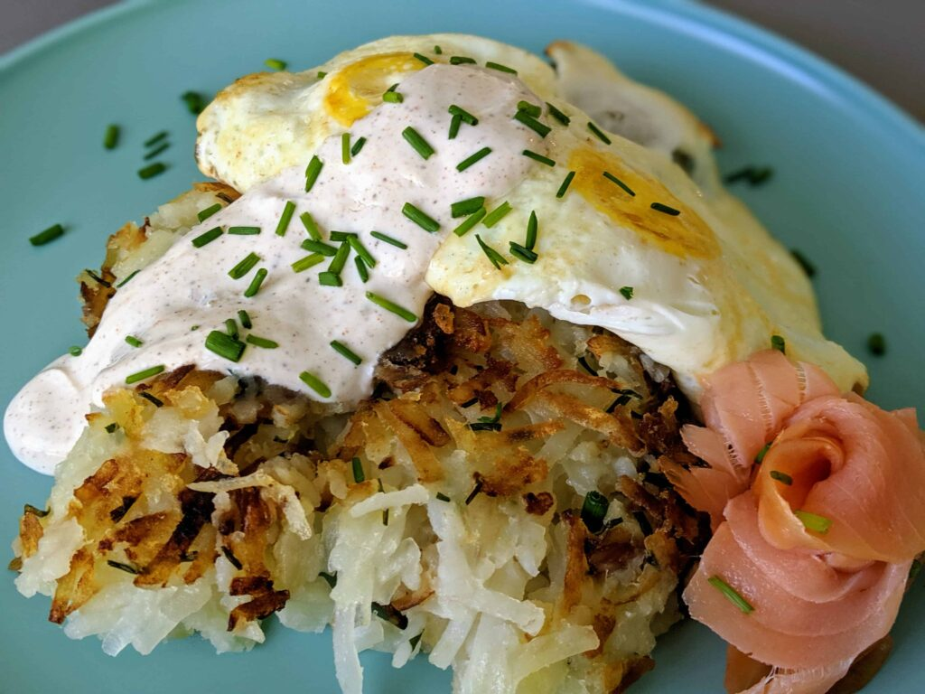 hashbrowns with a twist on a blue plate
