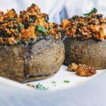 soy chorizo stuffed mushrooms on a white plate