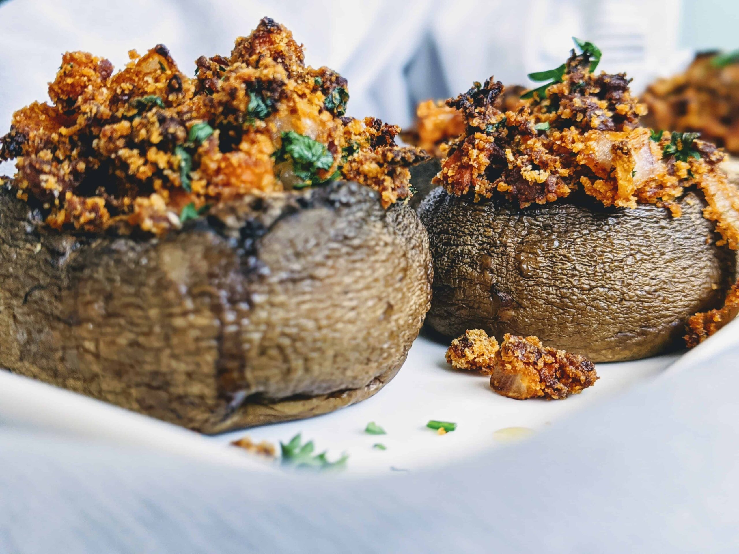 soy chorizo stuffed mushrooms on a white plate