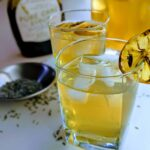 roasted lavender lemonade in a glass with a slice of lemon