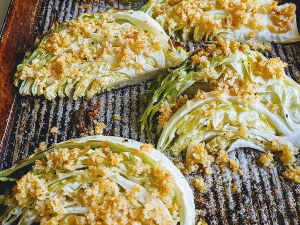crispy roasted cabbage wedges on a pan