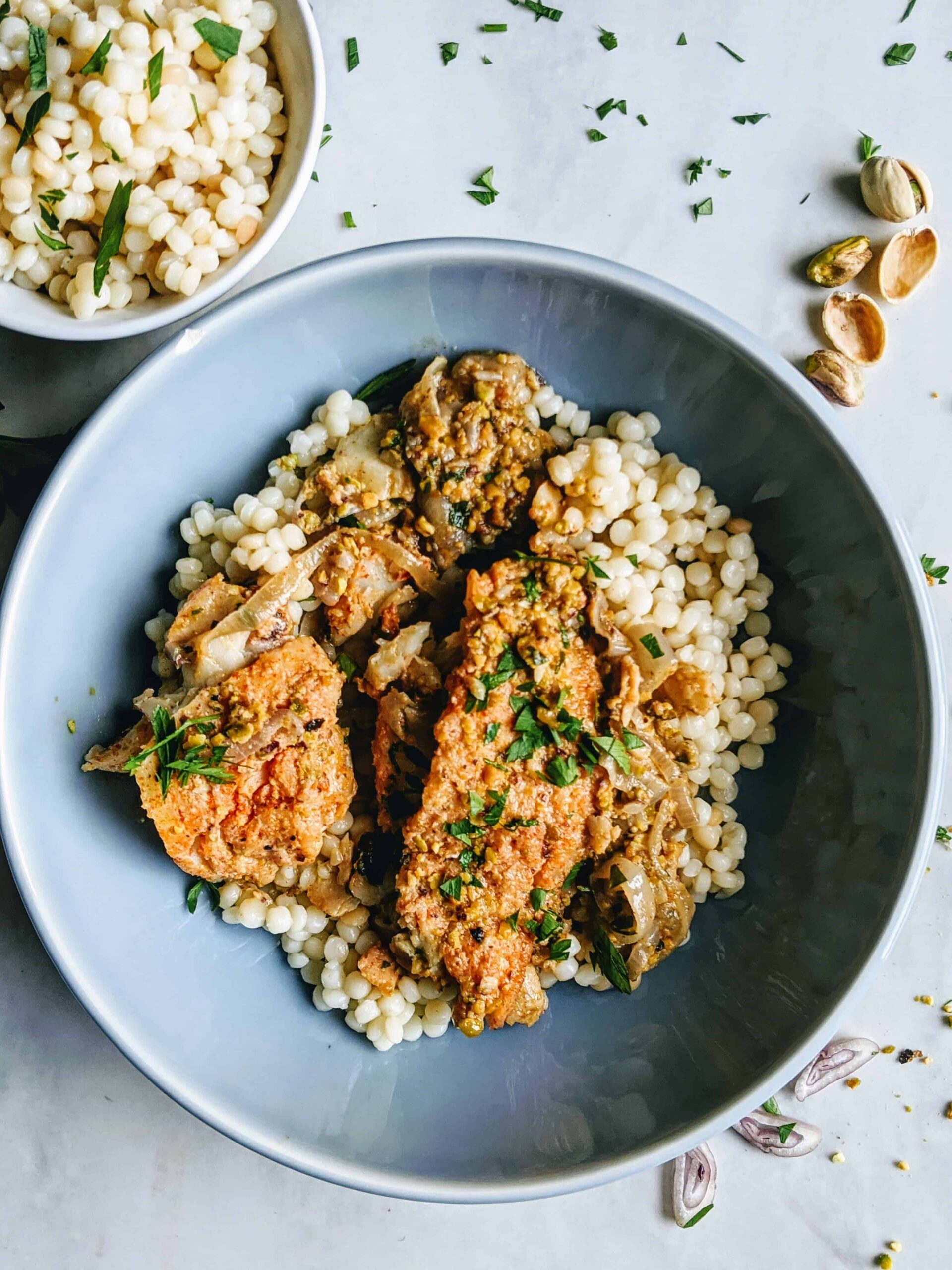 pistachio cod in a white wine butter sauce with couscous