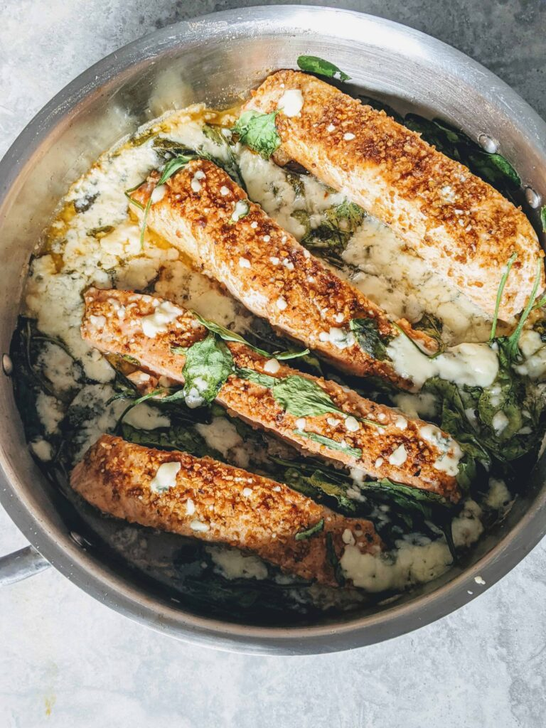 lemony gorgonzola salmon cooked in a pan