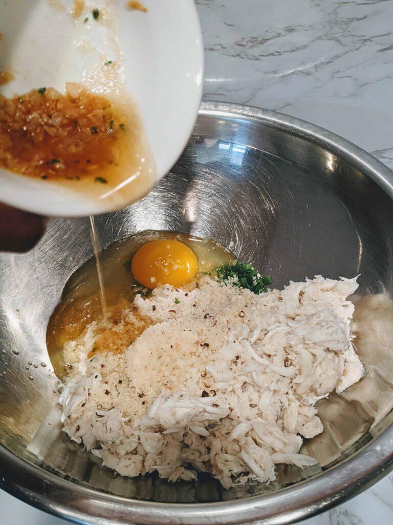 crabmeat, egg, seasonings in a silver bowl