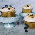 blueberry pomegranate cupcakes with cream cheese frosting