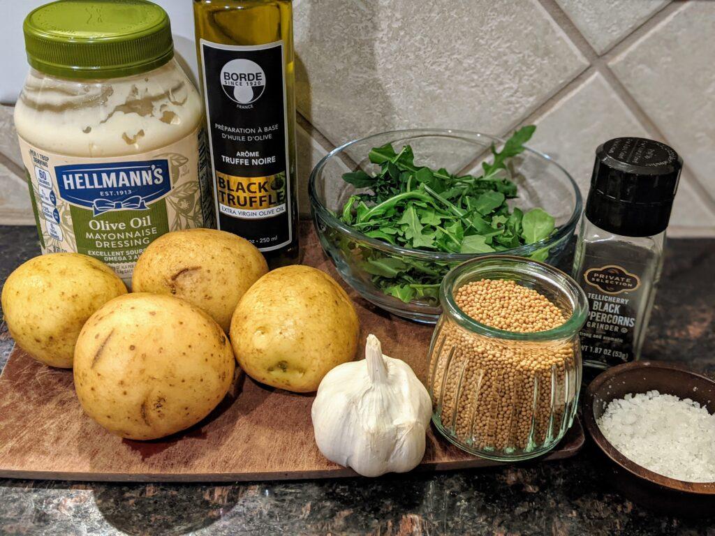 gold potatoes, mayo, garlic, arugula, truffle oil, salt, pepper, mustard seed
